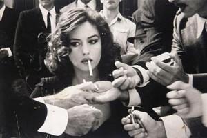 woman getting cigarette lit by many men