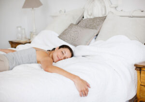 woman-alone-double-bed
